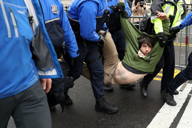 A protester is dragged away from a public access point to the National Mall on 14th Street NW prior to the inauguration on January 20, 2017 in Washington, DC. Donald Trump is being sworn in as the 45th President of the United States. (Patrick Smith/Getty Images)