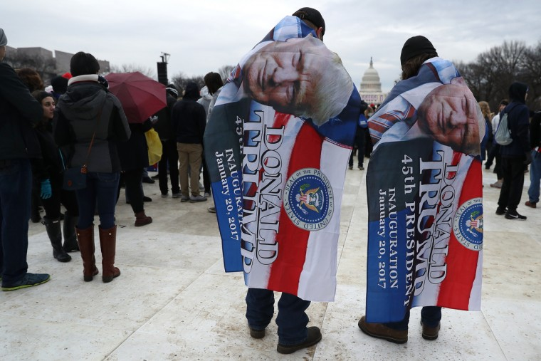 With the U.S. Capitol in the background, two Donald Trump supporters wait on the National Mall prior to the presidential inauguration on January 20, 2017 in Washington, DC. Donald Trump is being sworn in as the 45th President of the United States. (Patrick Smith/Getty Images)