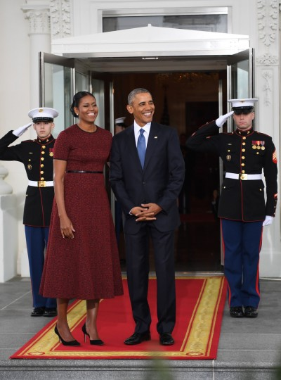 US President Barack Obama and First Lady Michelle Obama prepare to greet President-elect Donald Trump and his wife Melania to the White House in Washington, DC January 20, 2017.  (Jim Watson/Getty Images)