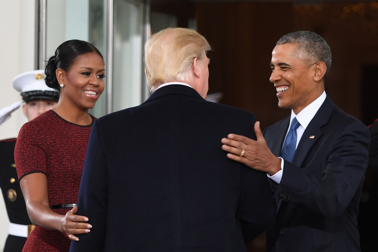 President-elect Donald Trump(C)is greeted by US President Barack Obama and First Lady Michelle Obama(L) as he arrives at the White House in Washington, DC January 20, 2017. (Jim Watson/Getty Images)