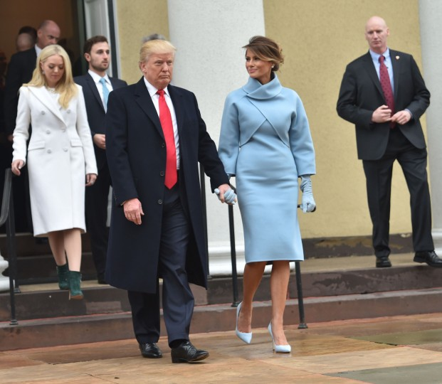 US President-elect Donald Trump and his wife Melania leave St. John's Episcopal Church on January 20, 2017, before Trump's inauguration. (Nicholas Kamm/Getty Images)