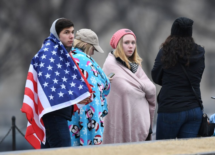 Supporters of US President-elect Donald Trump wait on the National Mall in Washington, DC, on January 20, 2017, before the swearing-in ceremony. (Andrew Caballero-Ryenolds/Getty Images)