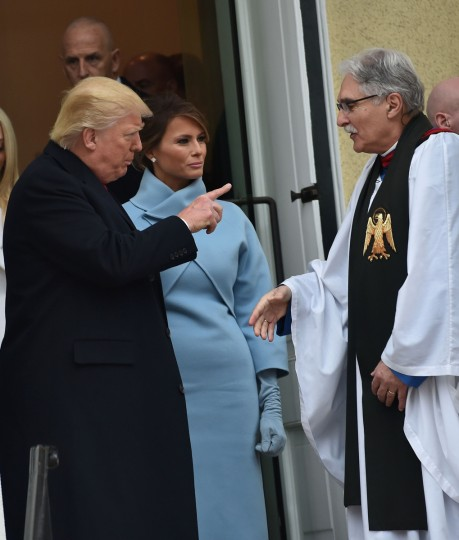 US President-elect Donald Trump and his wife Melania speak with Reverend Luis Leon as they leave St. John's Episcopal Church on January 20, 2017, before Trump's inauguration. (Nicholas Kamm/Getty Images)