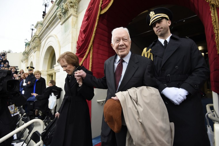 Former US President Jimmy Carter and First Lady Rosalynn Carter arrive for the Presidential Inauguration of Donald Trump at the US Capitol in Washington, DC, January 20, 2017. (Saul Loeb/Getty Images)
