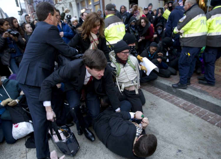 Inaugural attendees move through demonstrators attempting to block people entering a security checkpoint, Friday, Jan. 20, 2017, ahead of President-elect Donald Trump's inauguration in Washington. (  || CREDIT: JOSE LUIS MAGANA - AP PHOTO