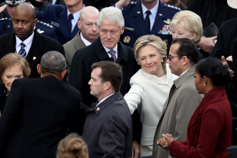 Former Democratic presidential nominee Hillary Clinton winks and shakes hands with President Barack Obama as former president Bill Clinton and Michelle Obama look on at the West Front of the U.S. Capitol on January 20, 2017 in Washington, DC. In today's inauguration ceremony Donald J. Trump becomes the 45th president of the United States.  (Joe Raedle/Getty Images)