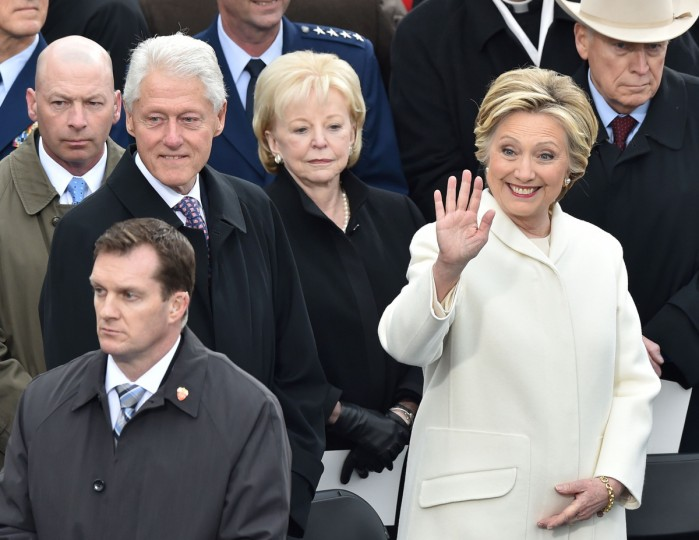 Former Us President Bill Clinton(L) and his wife Hillary Clinton(R) arrive on the platform of the US Capitol in Washington, DC, on January 20, 2017, before the swearing-in ceremony of US President-elect Donald Trump. (Paul J. Richards/Getty Images)