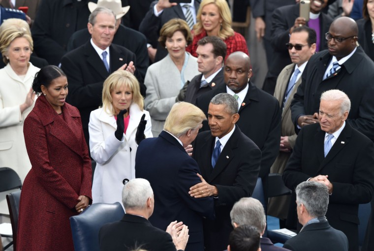 President-elect Donald Trump(C-left) is greeted by US President Barack Obama(C-right) as he arrives on the platform of the US Capitol in Washington, DC, on January 20, 2017, before his swearing-in ceremony to be the 45th president of the US. (Paul J. Richards/Getty Images)