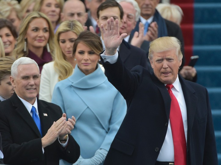 Vice-president elect Mike Pence (L) applauds as President-elect Donald Trump waves to the crowd as he arrives on the platform at the US Capitol in Washington, DC, on January 20, 2017, before his swearing-in ceremony. (Mandel Ngan/Getty Images)