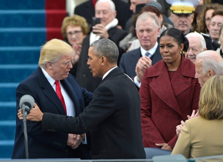 US President Barack Obama (R) greets President-elect Donald Trump as he arrives on the platform at the US Capitol in Washington, DC, on January 20, 2017, for his swearing-in ceremony. (Mandel Ngan/Getty Images)