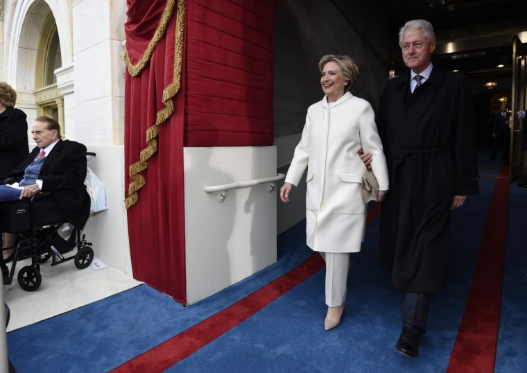 Former US President Bill Clinton and First Lady Hillary Clinton arrive for the Presidential Inauguration of Donald Trump at the US Capitol in Washington, DC, January 20, 2017.(Saul Loeb/Getty Images)