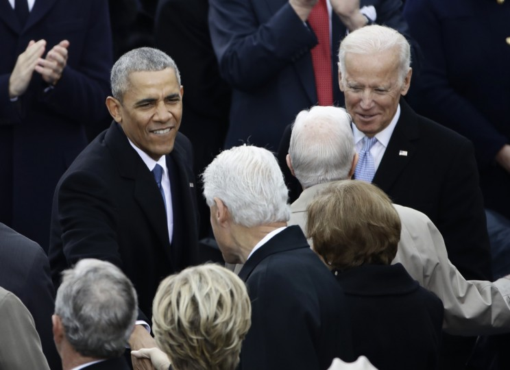 President Barack Obama greets Former President Bill Clinton before the 58th Presidential Inauguration at the U.S. Capitol in Washington, Friday, Jan. 20, 2017. Right is Vice President Joe Biden.  || CREDIT: MATT ROURKE - AP PHOTO