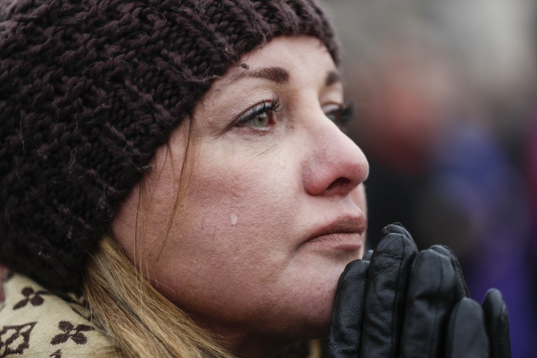 Cheryl Edmondson cries as President-elect Donald Trump appears for his inauguration, Friday, Jan. 20, 2017, in Washington.  || CREDIT: JOHN MINCHILLO - AP PHOTO