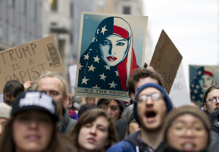 Demonstrators march on the street near a security checkpoint inaugural entrance, Friday, Jan. 20, 2017 in Washington, ahead of President-elect Donald Trump's inauguration. Protesters pitching diverse causes but united against the incoming president are making their mark on Inauguration Day.  (  || CREDIT: JOSE LUIS MAGANA - AP PHOTO