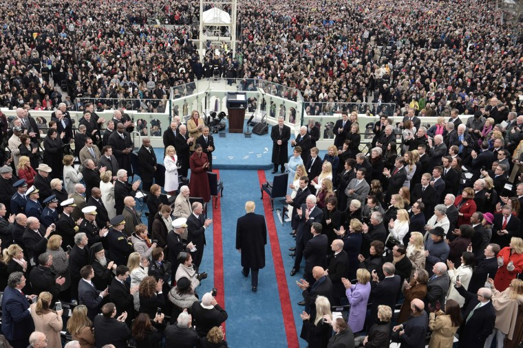 US President elect Donald Trump (C) arrives for the swearing-in ceremony on in front of the Capitol in Washington on January 20, 2017.  (Brendan Smialowski/Getty Images)