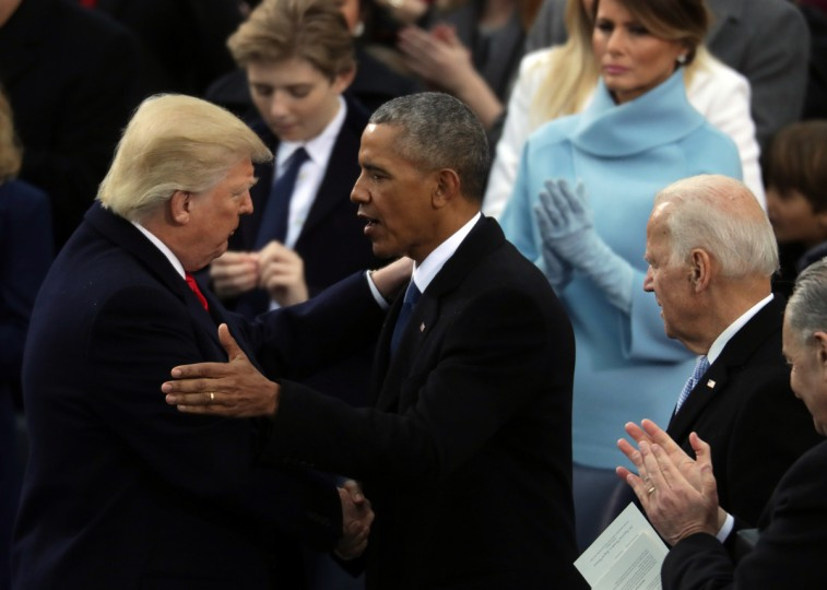 Former U.S. President Barack Obama (C) and former Vice President Joe Biden (R) congratulate U.S. President Donald Trump after he took the oath of office on the West Front of the U.S. Capitol on January 20, 2017 in Washington, DC. In today's inauguration ceremony Donald J. Trump becomes the 45th president of the United States.  (Chip Somodevilla/Getty Images)