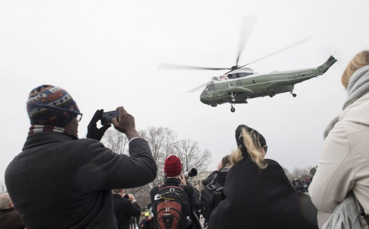 People watch as former President Barack Obama departs the inauguration via a helicopter, on Capitol Hill in Washington, D.C. on January 20, 2017. President-Elect Donald Trump was sworn-in as the 45th President. (Kevin Dietsch - Pool/Getty Images)