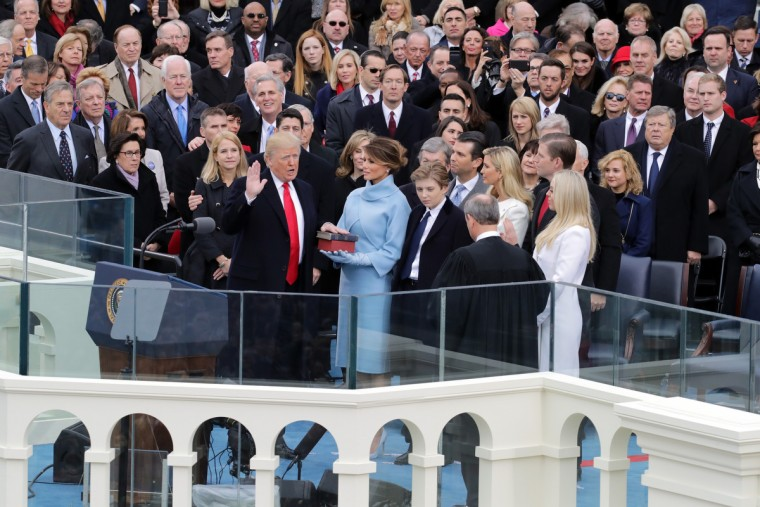 Supreme Court Justice John Roberts (R) administers the oath of office to U.S. President Donald Trump (L) as his wife Melania Trump holds the Bible on the West Front of the U.S. Capitol on January 20, 2017 in Washington, DC. In today's inauguration ceremony Donald J. Trump becomes the 45th president of the United States.  (Chip Somodevilla/Getty Images)