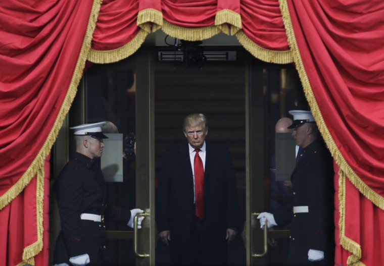 President-elect Donald Trump steps out to the portico to be sworn in as 45th president of the United States during the 58th Presidential Inauguration at the U.S. Capitol in Washington, Friday, Jan. 20, 2017.  || CREDIT: PATRICK SEMANSKY - AP PHOTO