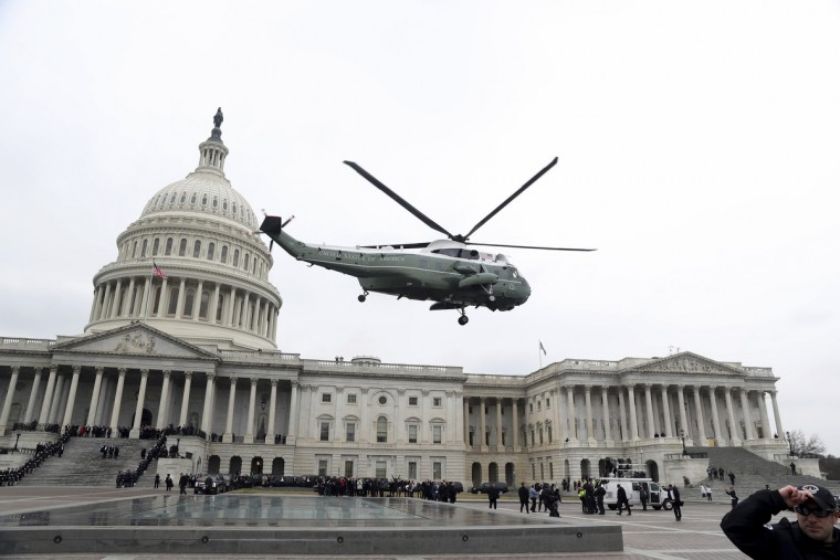 A military helicopter carries former president Barack Obama and Michelle Obama from the Capitol in Washington, Friday, Jan. 20, 2017, en route to Andrews Air Force Base, Md. during the inauguration ceremony Donald Trump. (Rob Carr/Pool Photo via AP)