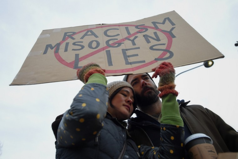 Protestors Lindsey Pei and her husband, Ben Leech of Lancaster, PA, are seen during the inauguration of President Donald Trump. (Lloyd Fox/Baltimore Sun)