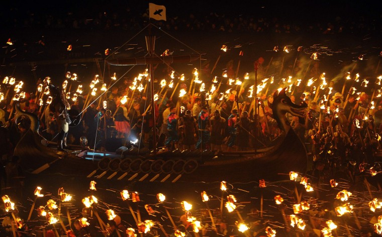 Participants dressed as Vikings prepare to burn their viking galley ship at the culmination of the annual Up Helly Aa festival in Lerwick, Shetland Islands, on January 31, 2017. Up Helly Aa celebrates the influence of the Scandinavian Vikings in the Shetland Islands and culminates with up to 1,000 'guizers' (men in costume) throwing flaming torches into their Viking longboat and setting it alight later in the evening. (Andy Buchanan/AFP/Getty Images)