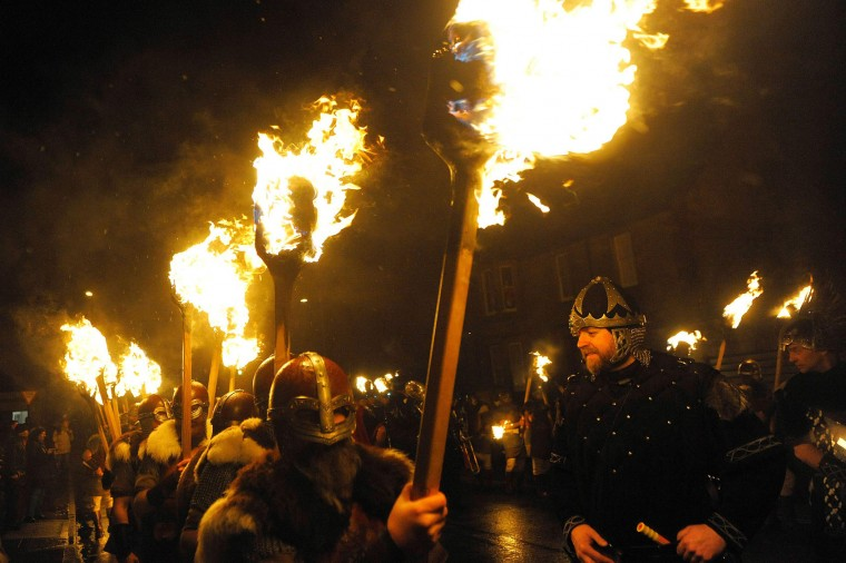 Participants dressed as Vikings carry torches as they march in processing beofre burning their viking galley ship at the culmination of the annual Up Helly Aa festival in Lerwick, Shetland Islands, on January 31, 2017. Up Helly Aa celebrates the influence of the Scandinavian Vikings in the Shetland Islands and culminates with up to 1,000 'guizers' (men in costume) throwing flaming torches into their Viking longboat and setting it alight later in the evening. (Andy Buchanan/AFP/Getty Images)