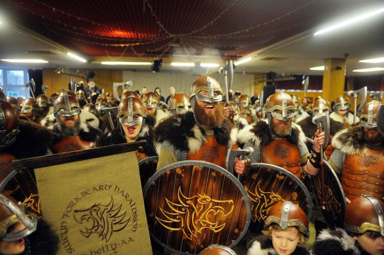 Participants dressed as Vikings wait to start the annual Up Helly Aa festival in Lerwick, Shetland Islands, on January 31, 2017. Up Helly Aa celebrates the influence of the Scandinavian Vikings in the Shetland Islands and culminates with up to 1,000 'guizers' (men in costume) throwing flaming torches into their Viking longboat and setting it alight later in the evening. (Andy Buchanan/AFP/Getty Images)