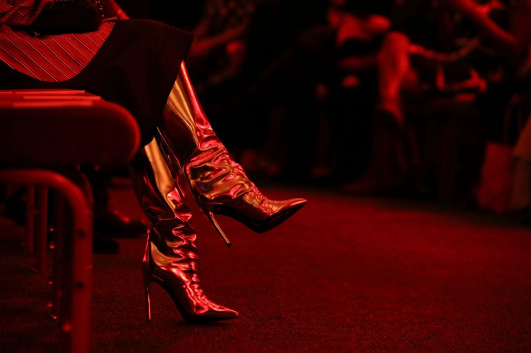 The boots of an audience member are seen at a catwalk show of creations by Chinese-born fashion designer Huishan Zhang during the fourth day of the Autumn/Winter 2017 London Fashion Week in London on February 20, 2017. (Daniel Leal-Olivas/AFP/Getty Images)