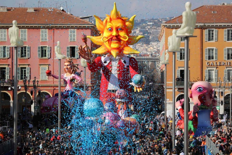 "People look at the float of the Nice Carnival King as it parades in the streets of Nice for the 133rd edition of the Nice Carnival on February 19, 2017 in Nice, southeastern France. The Nice carnival runs until February 25, 2017 under the theme ""The King of Energies"". (VALERY HACHE/AFP/Getty Images)"