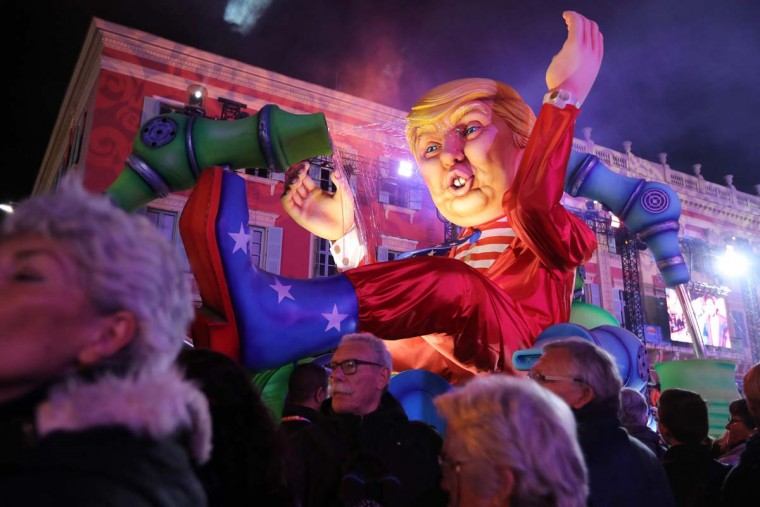 "People look at the ""Wind of Change"" float depicting US President Donald Trump as it parades during the 133rd edition of the Nice Carnival in Nice, southeastern France, on February 21, 2017. (VALERY HACHE/AFP/Getty Images)"