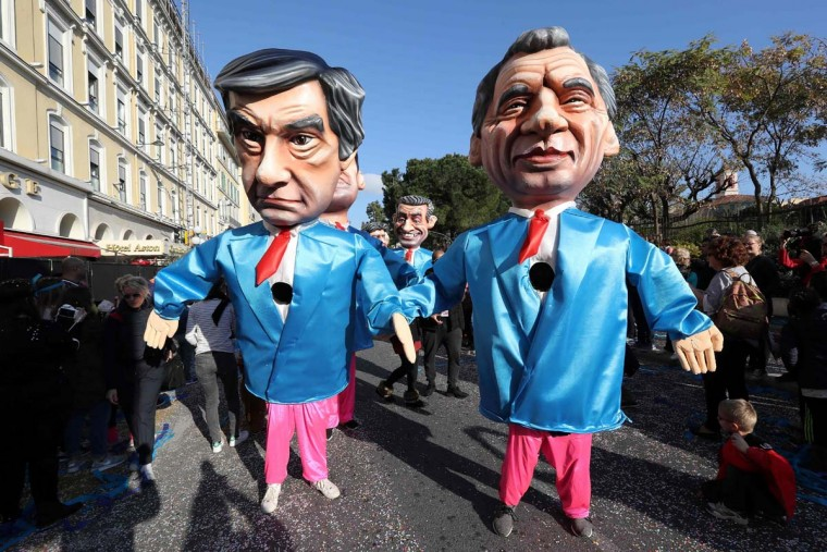 "Artists dressed up with costumes depicting French presidential election candidate for the right-wing Les Republicains (LR) party Francois Fillon (L) and president of the center right party Modem Francois Bayrou (R) parade in the streets of Nice during the 133rd edition of the Nice Carnival on February 19, 2017 in Nice, southeastern France. The Nice carnival runs until February 25, 2017 under the theme ""The King of Energies"". (VALERY HACHE/AFP/Getty Images)"
