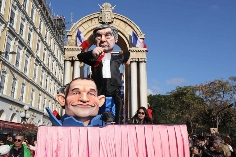 "A float depicting French presidential election candidate for the right-wing Les Republicans (LR) party Francois Fillon and French presidential election candidate for the left-wing French Socialist (PS) party Benoit Hamon parade in the streets of Nice for the 133rd edition of the Nice Carnival on February 19, 2017 in Nice, southeastern France. The Nice carnival runs until February 25, 2017 under the theme ""The King of Energies"". (VALERY HACHE/AFP/Getty Images)"