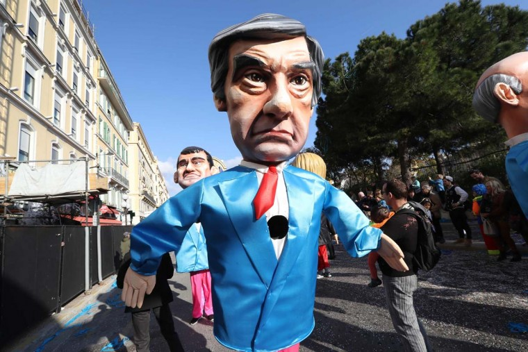 "An artist dressed up with a costume depicting French presidential election candidate for the right-wing Les Republicans (LR) party Francois Fillon parades in the streets of Nice for the 133rd edition of the Nice Carnival on February 19, 2017 in Nice, southeastern France. The Nice carnival runs until February 25, 2017 under the theme ""The King of Energies"". (VALERY HACHE/AFP/Getty Images)"