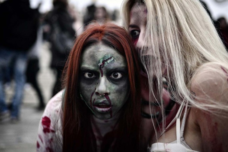 Two women take part in the Zombie Walk during carnival celebrations in the Greek capital Athens on February 25, 2017. (LOUISA GOULIAMAKI/AFP/Getty Images)
