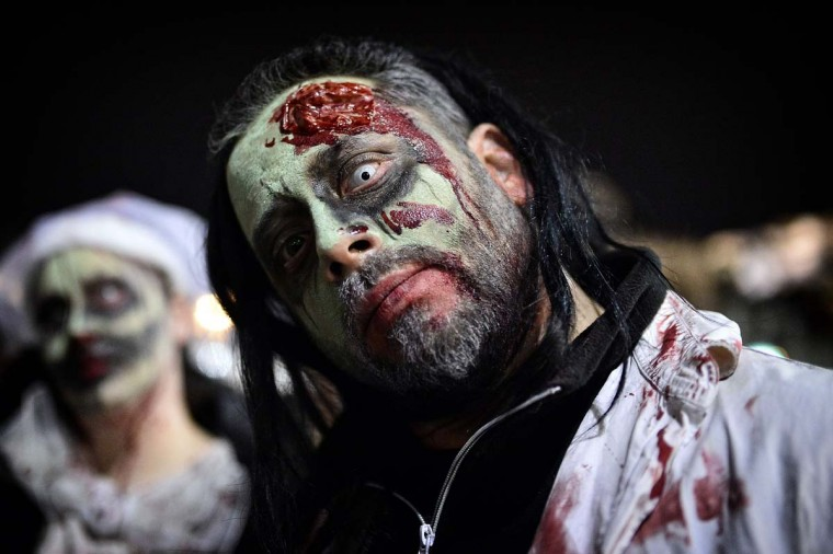 A man poses as he takes part in the Zombie Walk during carnival celebrations in the Greek capital Athens on February 25, 2017. (LOUISA GOULIAMAKI/AFP/Getty Images)