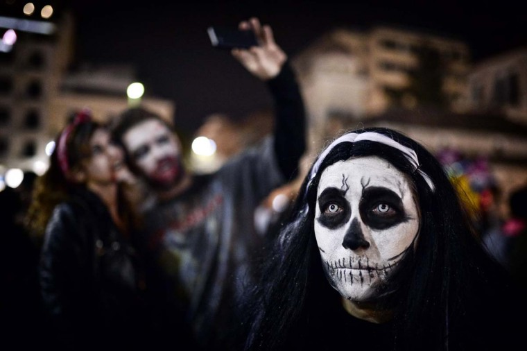 A woman takes part in the Zombie Walk during carnival celebrations in the Greek capital Athens on February 25, 2017. (LOUISA GOULIAMAKI/AFP/Getty Images)