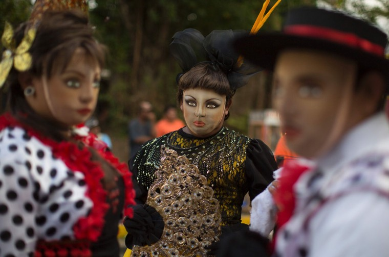 """Dancers dressed as traditional characters in the """"Baile de Negras"""" dance take part in the celebration of the feast day of the Virgin of the Candelaria (Candlemas) in the town of Diriomo, some 45 km from Managua, Nicaragua on February 2, 2017. Candlemas falls forty days after Christmas and is celebrated by Catholics as the presentation of Christ at the Temple. (AFP Photo/Inti Ocon)"""