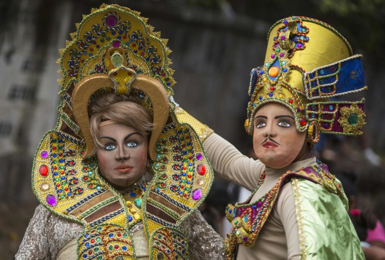"""Dancers dressed as traditional characters in the """"Baile de Negras"""" dance poses for a picture on the feast day of the Virgin of the Candelaria (Candlemas) in the town of Diriomo, some 45 km from Managua, Nicaragua on February 2, 2017. Candlemas falls forty days after Christmas and is celebrated by Catholics as the presentation of Christ at the Temple. (AFP Photo/Inti Ocon)"""