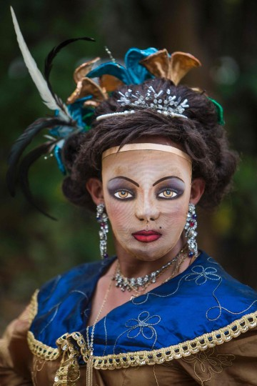 """A woman dressed as a traditional character in the """"Baile de Negras"""" dance poses for a picture on the feast day of the Virgin of the Candelaria (Candlemas) in the town of Diriomo, some 45 km from Managua, Nicaragua on February 2, 2017. Candlemas falls forty days after Christmas and is celebrated by Catholics as the presentation of Christ at the Temple. (AFP Photo/Inti Ocon)"""