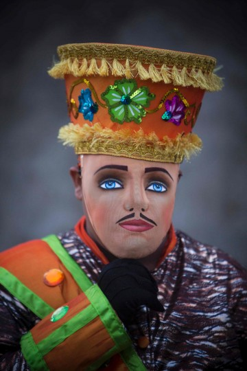 """A man dressed as a traditional character in the """"Baile de Negras"""" dance poses for a picture on the feast day of the Virgin of the Candelaria (Candlemas) in the town of Diriomo, some 45 km from Managua, Nicaragua on February 2, 2017. Candlemas falls forty days after Christmas and is celebrated by Catholics as the presentation of Christ at the Temple. (AFP Photo/Inti Ocon)"""