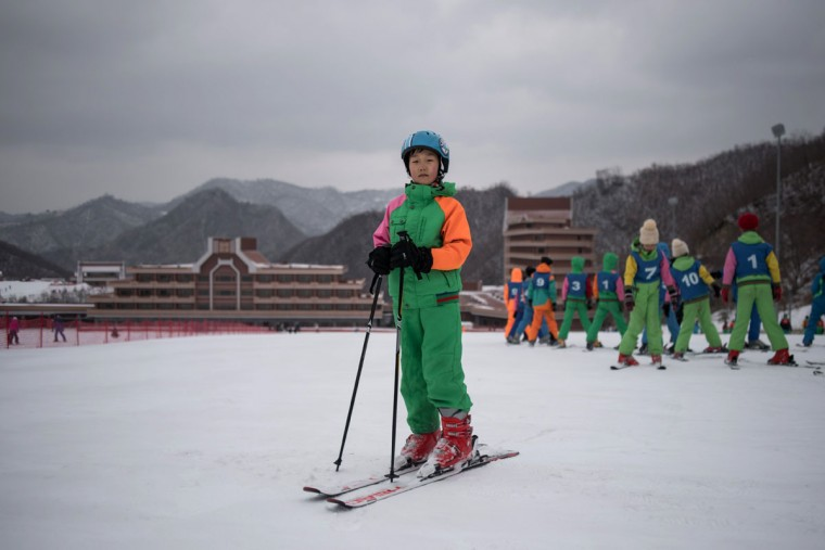 In this photo taken on February 19, 2017, Pak Han-Song, 11, poses for a portrait on a beginner's slope at the Masikryong, or Masik Pass, ski resort near Wonsan. AFP was told that Pak was a member of a youth ski camp. The Masik resort was opened in 2013. A price list at the ticket desk advertises a cost of 80 USD for a one-day lift pass and ski hire for foreign tourists, while North Koreans can expect to pay the equivalent of around 40 USD. / (AFP Photo/Ed Jones)