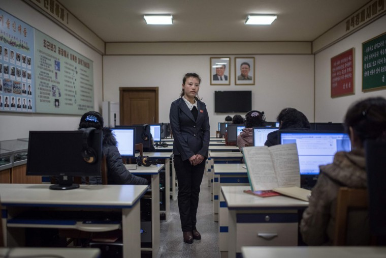In this photo taken on February 21, 2017, Ri Yong-Hwa, 23, poses for a portrait in a classroom at the Kim Jong-Suk silk mill in Pyongyang. A regular fixture on the itineraries of foreign journalists and tourists, the Kim Jong-Suk textile mill is named after the grandmother of current North Korean leader Kim Jong-Un. / (AFP Photo/Ed Jones)