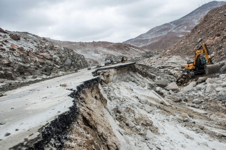 View of the Peruvian Panamerican highway after a landslide in Arequipa, southern Peru, on January 27, 2017. Floods and landslides in Peru have killed four people and displaced more than 11,000 families over recent weeks, the authorities said Friday. Three people drowned when their vehicle was caught in a flood in the southern Arequipa region, the National Civil Defense Institute said. (Ernesto Benavides/AFP/Getty Images)