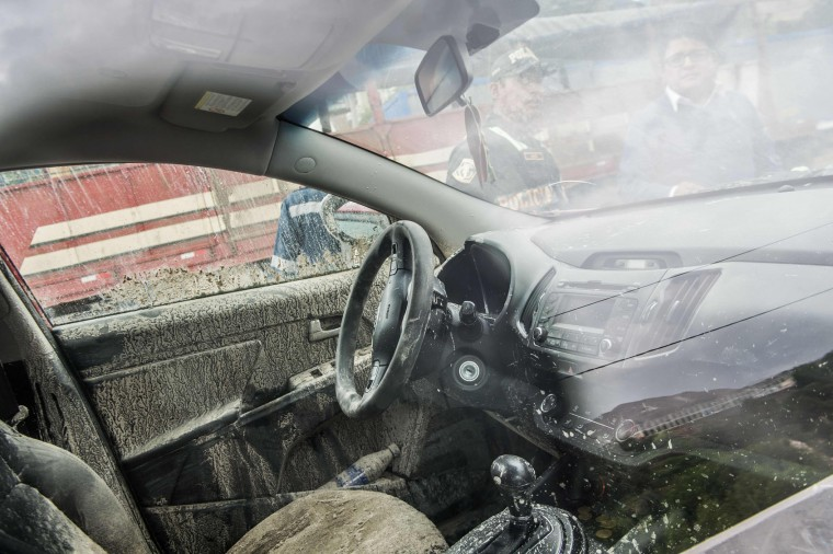 A car is seen at the Peruvian Panamerican highway after a landslide in Arequipa, southern Peru, on January 27, 2017. Floods and landslides in Peru have killed four people and displaced more than 11,000 families over recent weeks, the authorities said Friday. Three people drowned when their vehicle was caught in a flood in the southern Arequipa region, the National Civil Defense Institute said. (Ernesto Benavides/AFP/Getty Images)