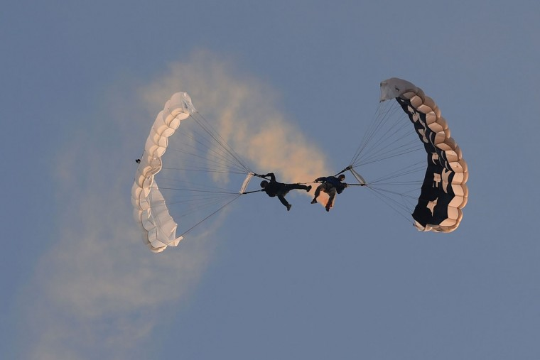Members of a local parachute group perform stunts during the annual International Hot Air Balloon Festival at the former Clark US Air Force base in Pampanga province, north of Manila on February 9, 2017. Some 29 balloon enthusiasts from around the globe are participating in the event which runs February 9 to 12. (TED ALJIBE/AFP/Getty Images)