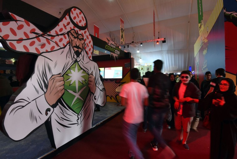 Saudis attend the country's first ever Comic-Con event in the coastal city of Jeddah on February 16, 2017. The three-day festival of anime, pop art, video gaming and film-related events is part of a government initiative to bring more entertainment to Saudi Arabia which bans alcohol, public cinemas and theatre. (Fayez Nureldine/AFP/Getty Images)
