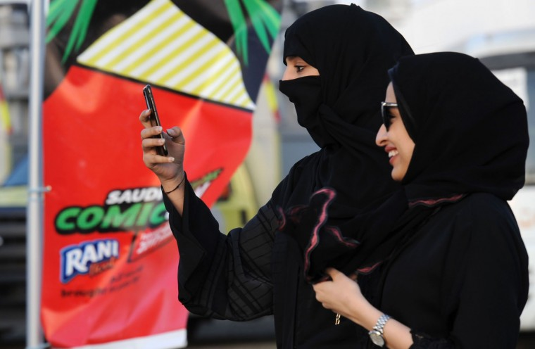 A Saudi woman films using her mobile during the first ever Comic-Con event in the coastal City of Jeddah, on February 16, 2017. The first edition of the US-based pop culture Comic-Con is being held in Saudi Arabia featuring a mix of robots, gaming and Saudi television and film industry luminaries. (Fayez Nureldine/AFP/Getty Images)