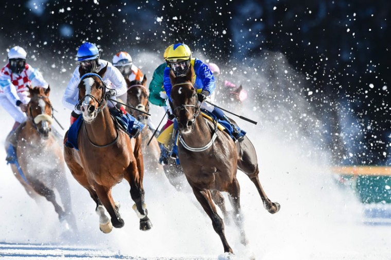 Competitors take part in a flat race at the White Turf horse racing event in St. Moritz on February 19, 2017. The races are held on the frozen lake of the Swiss mountain resort. (MICHAEL BUHOLZER/AFP/Getty Images)