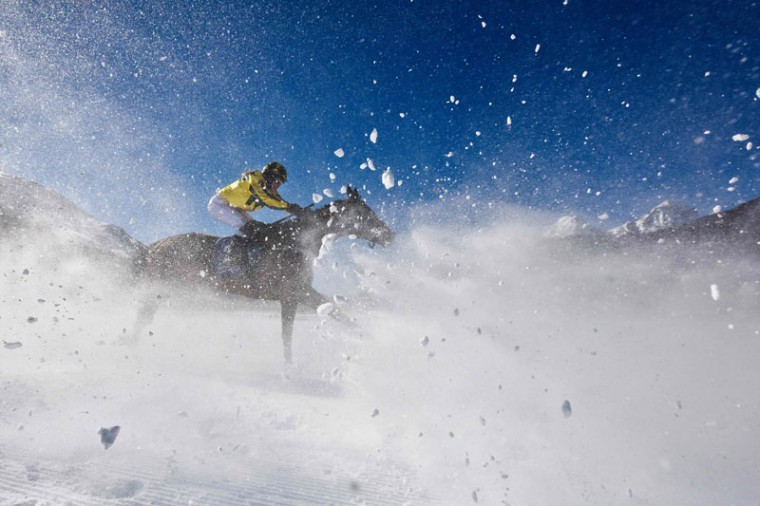 Sonja Daroszewski with her horse Ferro Sensation competes during the flat race of the White Turf horse racing event in St. Moritz on February 19, 2017. The races are held on the frozen lake of the Swiss mountain resort. (MICHAEL BUHOLZER/AFP/Getty Images)